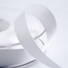 White satin ribbon which comes in 3mm, 6mm, 10mm, 16mm, 25mm and 38mm widths.