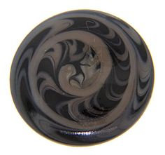 """A swirling design ornaments this antique button. The blown glass button measures 1"""" in diameter."""