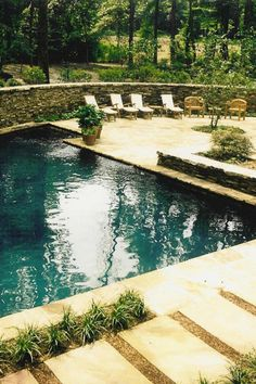 Artesian Spring Fed Dark Bottom Pool, with French Limestone Surround.
