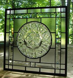 I designed this stained glass panel with vintage crystal glassware as the centerpiece. This old dish was created many years ago by the