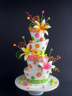 Wow, that is a cake! Looks like the party already started the guest havent arrive yet! Colorful fun party cake with polka dots, white icing, flowers .... more cool pins at http://www.Pinterest.com/jazevox
