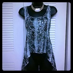 Snakeskin print tank Asymmetric tank in metallic reptile print. Sleeveless. Junior fit. Polyester Almost Famous Tops Tank Tops