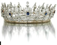 From 1900's a diamond and sapphire belle epoque tiara with thirteen elaborate foliate scroll motifs, each with a central sapphire. Sold via Sotheby's on 17 November 2009 for CHF85,300. http://www.sothebys.com/en/auctions/ecatalogue/2009/magnificent-jewels-ge0905/lot.221.html