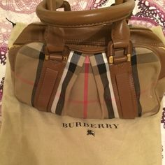✨1day Sale Like New Sm Burberry Ashbury -Dark Tan An unmistakable classic Burberry check, this purse is sure to turn heads. Only carried a couple times, but it is one of my favorites.  Listed as I'm considering getting a bigger one. No scratches, no tarnish. Lowballing.  ✅ FREE SHIPPING. TRADES.  luxorshpr g mail with questions. (ALTERNATE LISTING AVAILABLE) Burberry Bags Satchels