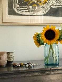 Always a small vase of fresh flowers on the table in the front hallway.