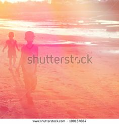 Two kids walking on the beach in sunset - instagram effect by Melissa King, via Shutterstock