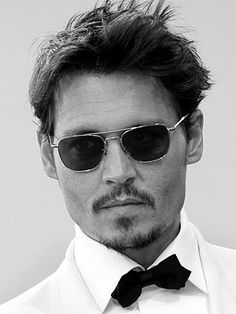 Johnny Depp - Oh heck yea, I'd go to bed with this man in the blink of an eye!!! Yummy!!!