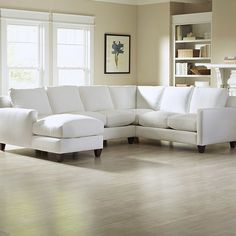 Relax in style on the sophisticated Kerry U-Shaped Sectional, which includes a corner sofa, loveseat, and chaise to comfortably seat up to six. Sleek features include track arms, bordered back and seat cushions, and tapered block wood legs. Blended-down pillows add a luxe touch.