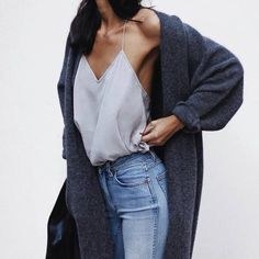 - delicate cami tucked into jeans with an oversized sweater