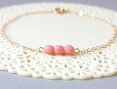 i want this. Milky Pink Czech Bead Bracelet . dainty jewelry . gold filled chain. $16.50, via Etsy.
