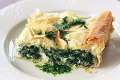 Spanakopita, the winner of this week's food fight, is a traditional spinach or silver beet pie with cheese and herbs, enveloped by crispy, flaky filo pastry. Greek Spinach Pie, Spinach And Feta, Frozen Spinach, Vegetarian Recipes, Cooking Recipes, Healthy Recipes, Healthy Food, Savoury Recipes, Meal Recipes