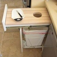 cutting board with easy access to garbage can. or better yet, compost bowl!!!