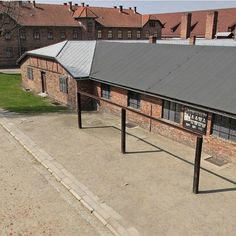 On July 19 1943 a large gallows with 12 nooses was built on the square in front of the Auschwitz I camp kitchen. After the evening roll-call 12 prisoners handcuffed and wearing only overalls were brought from Block 11. They were 12 Poles from the surveying squad who had been locked in the camp prison on May 21 26 and 27 1943.  They were: Stanisław Stawiński (No. 6569) Czesław Marcisz (No. 26891) Janusz Skrzetuski-Pogonowski (No. 253) Edmund Sikorski (No. 25419) Jerzy Woźniak (No. 35650)…