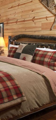 In this charming cabin bedroom, the designer chose a reversible duvet cover that is solid on one side and reverses to a plaid pattern on the other. The shams and throw cushions have a beautiful rustic Plaid Bedroom, Bedroom Red, Red Bedrooms, Luxury Bedrooms, Rustic Bedroom Design, Rustic Bedrooms, Cabin Bedrooms, Western Bedrooms, Bedroom Furniture