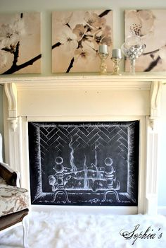 """Kristen from Sophia's Decor created this gorgeous faux fireplace with a chalkboard """"fire"""" insert. I think it's brilliant and looks classy and playful at the same time."""
