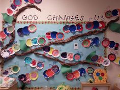 My co-worker's bulletin board for Spring....God changes us!  <3 it!