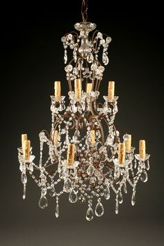 Late 19th century Italian iron and crystal 12 arm antique chandelier, circa 1870. #antique #chandelier #iron #crystal