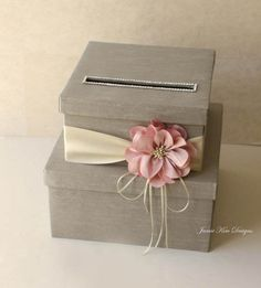 This wedding card box is beautifully made with silk shantung, premium quality double faced satin ribbon and Silk Flower.