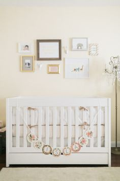 Modern Neutral Baby Girl Nursery - love the sweet gallery wall over the crib!