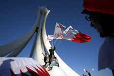 Bahrain — Triumphant protesters wave flags in Pearl Square.