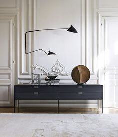 If Swedish and modern French interiors have taught us anything, it's that a well-chosen light can be truly transformative. This is especially true if your home has traditional moldings like this...