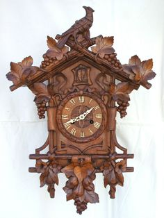 """ANTIQUE BEHA / Ketterer 112 Black Forest Double Fusee Cuckoo Clock - $2,604.27. FOR SALE! Magnificent Antique Beha / Ketterer Twin fusee Wood Plate Cuckoo Clock 1880c Superb Deep Quality Carving in Beautiful Condition Impressive Carved Cuckoo Wall Clock 26""""1/2 High, 17""""1/2 Wide, 8""""3/4 Depth Massive Twin Fusee 8 Day Spring Driven Movement, size 9""""1/2 High, 8"""" Wide I believe this is Number 112 style 252533550293 Antique Mantle Clock, Study Pictures, Wood Carving Patterns, Side Door, Black Forest, Im Not Perfect, Cuckoo Clocks, Two By Two, Antiques"""