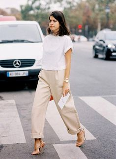 Leandra Medine of The Man Repeller dresses up her simple shirt and trousers by pairing them with a colorful choker and snakeskin heels. // #Fashion