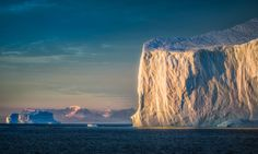A giant iceberg greeting the sun on an early morning in Eastern Greenland. Not one of my ultra-wide images for a change... sometimes even I take out the 200 mm ;-)   Prints are now available for all of my images. Head over to the About-section of my web page to find out more!