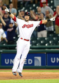 Cleveland Indians Yan Gomes jumps in the air after knocking in Lonnie Chisenhall with the winning run in the 11th inning against the Texas Rangers at Progressive Field on June 1, 2016.   Indians won 5-4.  (Chuck Crow/The Plain Dealer)