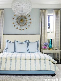Blue bedroom. Design: Hillary Thomas and Jeff Lincoln. Photo: Eric Piasecki. housebeautiful.com. #bedroom #blue #prints #chandelier #glass_lamp