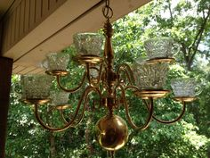 I chose clear punch cups to attach to my $10 thrift shop chandelier.... Now just need to decide on T*light Candles or Birdseed!