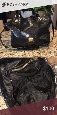Marc by Marc Jacobs tote Marc By Marc Jacobs snake embossed black tire bag. This bag is pretty large- with lots of room to carry anything you may need through out the day. It's super clean- I only carried it a few times. Marc by Marc Jacobs Bags Hobos