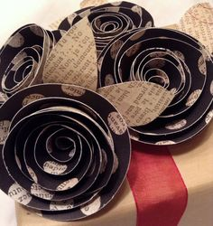 """This is a set of four holiday """"bows"""". These are a clever replacement to the standard and expected holiday bow. Each is appox 2.5 inches and has coordinating leaves. They come with double sided tape so"""