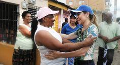 Carolina, Hipolito y David Collado en mano-a-mano en barrios pobres la capital