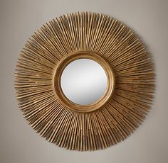 RH's 17th C. Round Sunburst Mirror:Replicating the ornate splendor of a 17th-century Spanish Colonial reliquary, our mirror is framed with a multitude of carved wood sunburst rays, painted to evoke the vintage luster of aged gold leaf.