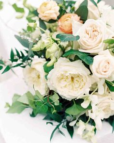 A Fashionable Country-Club Wedding in St. Louis | Martha Stewart Weddings - Ken Miesner's Flowers created Louisa's bouquet of assorted roses, ranunculus, and greenery.