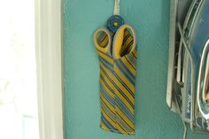 Use an old neck tie to make a scissor holder! *Okay that is too cool why can I not come up with these creative things.*