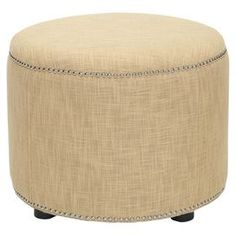Beech ottoman with linen upholstery and nailhead trim.   Product: OttomanConstruction Material: Beech wood and linenColor: GoldFeatures:  Functionality and versatilityLovely circular design and unique nailhead trimCan be used a foot rest or as an accent piece in any room Dimensions: 18 H x 24 Diameter