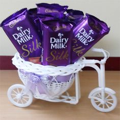 Enrich the excitement of your loved ones with the bunch of cadbuary diary milk silk chocolates arranged in the bicycle - basket. Send this Chocolate basket to your dear ones and make them feel happy and special through our Chocolate Basket, Dairy Milk Chocolate, Cadbury Dairy Milk, Cadbury Chocolate, Chocolate World, I Love Chocolate, Chocolate Bouquet, Chocolate Ice Cream, Chocolate Gifts