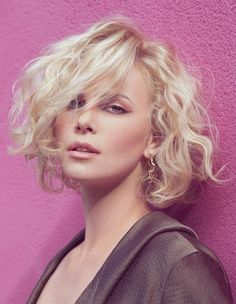 Actress Charlize Theron is beautifully captured by photographer Dusan Reljin in the July 2010 issue of French Elle.
