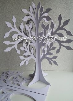 The Family Tree. Basically a wooden free standing 3D tree which can be used for crafts, Christmas,Christening, Easter, birthday,wedding guestbook, jewellery stand. Wishing tree or family tree etc. Also available in other designs at www.myourcrafts.co.uk