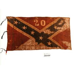The 20th Alabama Flag carried by the regiment in 1864. Itwas hidden under the clothing of the regiment's flag-bearer to avoid surrendering it to Federal forces in 1865 and eventually made its way into the Alabama Dept. of Archives and History in1943.