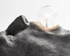 CEK's sculpted concrete lamps at IDS blend body parts and light bulbs