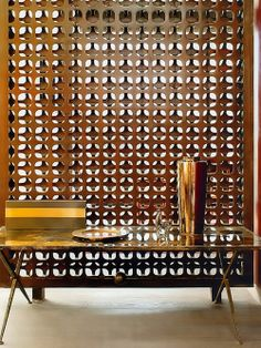 Such a contemporary and yet very asian idea for a lobby decoration. Love the golden table