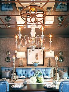 An elaborate mirrored ceiling steals the show in this dining room. Plush blue dining chairs, graphic wallpaper and mercury glass decor give the entertaining space an updated, transitional look. Tan Dining Rooms, Dining Room Design, Dining Tables, Living Rooms, Mirror Ceiling, Ceiling Decor, Jamie Durie, Beautiful Room Designs, Romantic Living Room