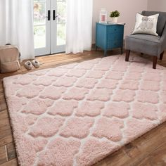Brighten your little one's room with the youthful design in the Riley shag rug. The incredible soft pile is made of 100-percent polyester microfiber over 1-inch thick and hand-tufted with a high and l