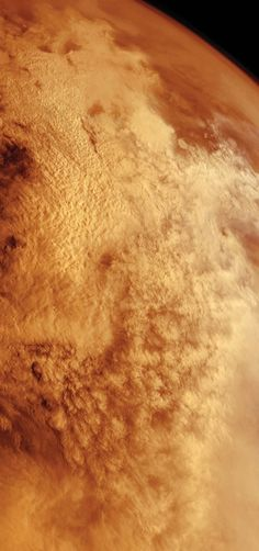 A global dust storm blankets the surface of Mars; photographed by Viking Orbiter 2 in 1977.