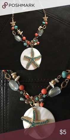 Charming Charlie's Beach Theme Necklace Very cute summer beach theme necklace with blues whites golds and peach. Gently used condition Charming Charlie Jewelry Necklaces