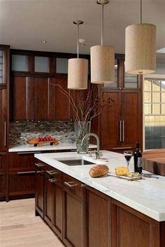 Kitchen Backsplash Cherry Cabinets White Counter kitchen cabinetry doesn't have to match. a creamy white island is