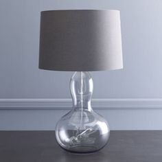 The smoked gray glass on this gourd lamp gives it an updated '70s feel. This is one of the lamp base shapes that we come back to again and again.  Object Lesson: The Gourd Lamp